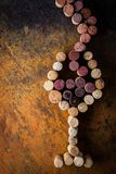 Glass of wine made by cork on the colorful background Royalty Free Stock Photography
