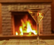 Martini glass under fireplace background. Glass of wine martini before fireplace background Stock Photos