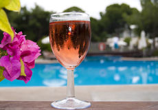 The glass of wine near swimming pool Stock Photo