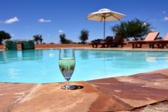 Glass of wine near swimming pool Stock Photo