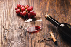Glass with wine next to the bunch of grapes Stock Images