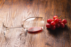 Glass with wine next to the bunch of grapes Stock Photo