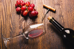 Glass with wine next to the bunch of grapes Stock Image