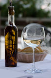 Glass of wine, olive oil and bread Stock Image