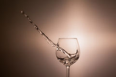 A glass of wine one. Spilling wine from a glass Royalty Free Stock Photography