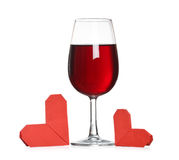 Glass of wine with origami hearts Stock Photo