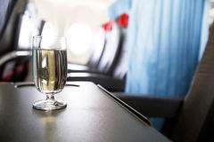 Glass of wine in the plane. Photo of glass of wine in the plane stock photos
