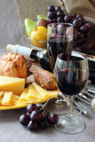 Glass of wine and a plate of cheese. Royalty Free Stock Images