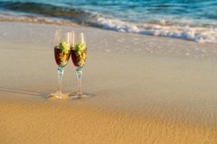 Glass of wine in the rays of the sunset. Glass on the sand. Romantic evening on the island. Concept of leisure and travel. Beautiful glass with wine of the royalty free stock photos