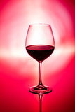 Glass of wine on red Royalty Free Stock Photography