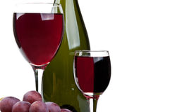 Glass of wine and red grapes Stock Photography