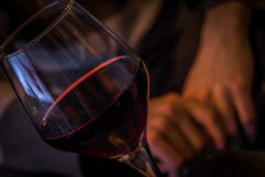 Glass of wine. Glass of red wine at a private party Royalty Free Stock Image