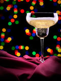 Glass of wine on red silk Stock Photo