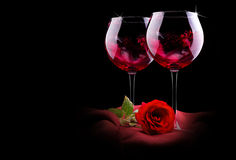 Glass of wine with red silk and flower Royalty Free Stock Images