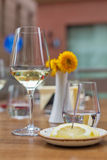 A glass of wine in restaurant. Shallow DOF. A glass of white wine on a wooden table Stock Photo