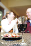 Glass of wine with romantic couple Royalty Free Stock Image
