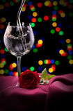 Glass of wine and rose on black Royalty Free Stock Images