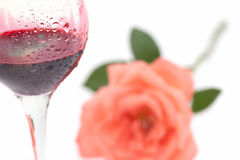 Glass of wine and roses with water drops Stock Image
