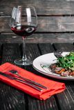Glass of wine and salad with warm veal Royalty Free Stock Photo