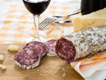 Glass of wine and salami Stock Photography