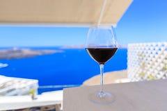Glass of wine Santorini stock photo