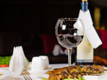 Glass of Wine Served with Ribs in Restaurant Stock Photos