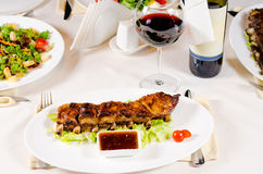 Glass of Wine Served with Ribs in Restaurant Stock Images