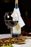 Glass of Wine Served with Ribs in Restaurant Royalty Free Stock Photo