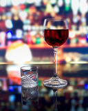 A glass of wine and a shot of vodka Royalty Free Stock Images