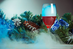 Glass with wine and smoke Royalty Free Stock Images