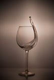 A glass of wine. Spilling wine from a glass stock image