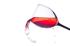 Glass of wine spilling Royalty Free Stock Photography