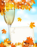 A glass of wine standing with a greetin card Stock Photography