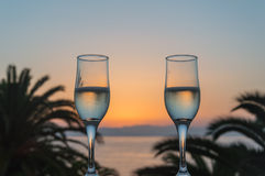 Glass of wine at sunrise at sea. Glass of wine at sea royalty free stock photo