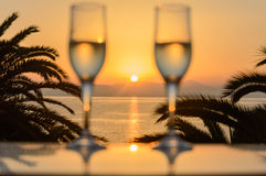 Glass of wine at sunrise at sea. Glass of wine at sea royalty free stock photos
