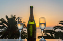 Glass of wine at sunrise at sea. Glass of wine at sea stock photo