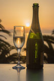 Glass of wine at sunrise at sea. Glass of wine at sea royalty free stock images