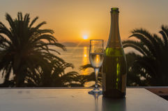 Glass of wine at sunrise at sea. Glass of wine at sea stock photography