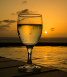 Glass of wine in the sunset Stock Photo