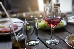 Glass of wine on table at the lunch time. Glass of wine on table at the lunch time Royalty Free Stock Images