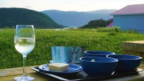 Glass of wine with a view of Newfoundland stock photo