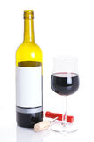 Glass of wine and wine bottle. Bottle with a blank label and glass of red wine, with cork and a corkscrew, on white background Royalty Free Stock Photography