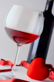 Glass of wine and wine bottle Royalty Free Stock Photo