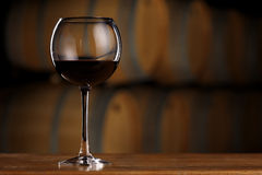 Glass of wine in wine cellar Royalty Free Stock Image