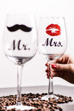 Glass of wine with woman´s hand on a white background. Glasses for woman and man. White wine. Happy lifestyle. Romantic. Stock Photos