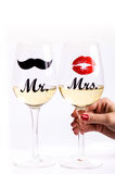 Glass of wine with woman´s hand on a white background. Glasses for woman and man. White wine. Happy lifestyle. Romantic. Stock Photography