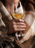 Glass of wine. In woman's hands Royalty Free Stock Photos