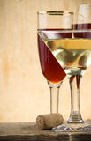 Glass of wine on wood Stock Photography