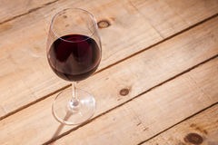 Glass of wine on wood Stock Photos