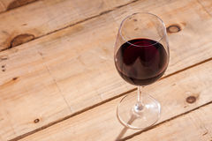 Glass of wine on wood Royalty Free Stock Image